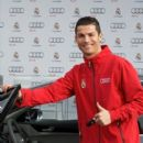 Real Madrid player Cristiano Ronaldo receives a new Audi S8 at the Ciudad deportiva del Real Madrid on December 1, 2014 in Madrid, Spain