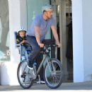 Josh Duhamel is spotted enjoying a bicycle ride with his growing son Axl on January 8, 2016 in Brentwood - 454 x 340