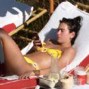Dua Lipa – Wearing yellow bikini in Miami - 454 x 320