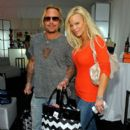Musician Vince Neil (L) and wife Lia Gherardini pose in the Official Silver Spoon Gifting Lounge held during the 2008 American Music Awards at the Nokia Theatre on November 22, 2008 in Los Angeles, California.