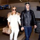 Paris Hilton and River Viiperi arrive at LAX (Los Angeles International Airport)