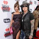 Nikki Sixx and Courtney Sixx attend the iHeartRadio Music Awards at The Forum on April 3, 2016 in Inglewood, California. - 399 x 600