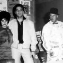 Priscilla and Elvis Presley with Col. Tom Parker - 359 x 297