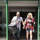 Katerina Karavatou and Krateros Katsoulis- leaving the maternity clinic - 454 x 610