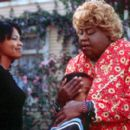 Sherry (Nia Long) and her son Trent (Jascha Washington) meet her aunt, a crass Southern granny known as Big Momma (Martin Lawrence) in 20th Century Fox's Big Momma's House - 2000