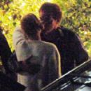 Uma Thurman and director Quentin Tarantino leaned in for a quick kiss after having dinner together in Beverly Hills, Calif. on Tuesday, June 17,2014