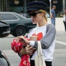 Paris Hilton with her dog out in West Hollywood