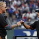 Kirk Hammett & James Hetfield celebrate after performing the national anthem before the game between the San Francisco Giants and the Chicago Cubs at AT&T Park on August 7, 2017 in San Francisco, California - 454 x 303