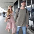 Paris Hilton and Chris Zylka at LAX Airport in Los Angeles - 454 x 679