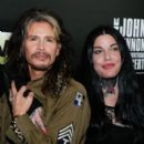 Steven Tyler and Mia Tyler attend the Imagine: John Lennon 75th birthday concert at Madison Square Garden on December 5, 2015 in New York City.