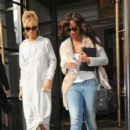 Rihanna is swamped by fans and paparazzi as she leaves her hotel in preparation for the BRIT Awards on February 21, 2012 in London
