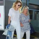 Model Candice Swanepoel and her mother arrive on a flight at LAX Airport in Los Angeles, California on September 26, 2014