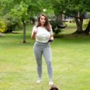 Lauren Goodger – Pictured while playing with a Dachshund in a park in Essex - 454 x 626