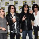 Kiss attends the Scooby-Doo! and Kiss: Rock and Roll Mystery Press Room during Comic-Con International 2015 at the at Hilton Bayfront on July 9, 2015 in San Diego, California. - 454 x 334