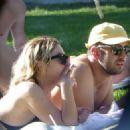 Ashley Benson in Black Bikini in Miami