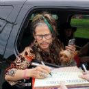 Steven Tyler is seen signing autographs for fans