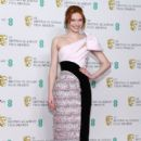 Eleanor Tomlinson attends the EE British Academy Film Awards at Royal Albert Hall on February 10, 2019 in London, England - 400 x 600
