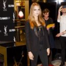 Cara Delevingne attends a photocall for the YSL Beauty: YSL Loves Your Lips launch at Selfridges on January 20, 2015 in London, England