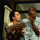Norm MacDonald as Willard Fillmore and Dave Chappelle as Rusty P. Hayes in Universal's comedy Screwed - 2000
