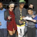 Amber Rose and Wiz Khalifa at the Jay Z Concert at the Staples Center in Los Angeles, California - December 9, 2013 - 454 x 656