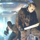 Peter Mensah battles Kane Hodder as Jason Voorhees in New Line's Jason X - 2002