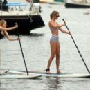Taylor Swift and close friend Ed Sheeran paddleboarding with their families near Taylor's home on Rhode Island