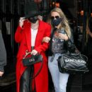 Miley Cyrus – In a red trench coat and black leather pants out in New York