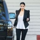 Kim Kardashian departs a studio in Los Angeles. 12/06/2011