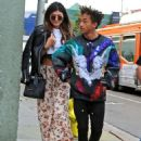 Jaden Smith puts his arms around Kylie Jenner and shows her an item while shopping together at Crystalarium on Tuesday (November 19) in West Hollywood, Calif - 454 x 633
