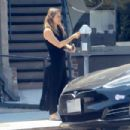 Alicia Silverstone – Feeding the meter in Beverly Hills - 454 x 303