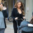 Chrissy Teigen is all smiles while out and about in New York City, New York with her baby girl Luna on October 14, 2016