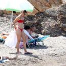 Maria Sharapova in Red Bikini on the beach in Isola d'Elba - 454 x 303
