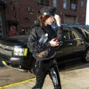 Bella Hadid in black leaving a building in NYC