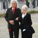 Brian May and Anita Dobson attend a service of thanksgiving for Lady Soames at Westminster Abbey on November 20, 2014 in London, England