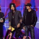 Motley Crue (L-R) Vince Neil, Nikki Sixx, Tommy Lee, Mick Mars on stage at the 3rd Annual Revolver Golden God Awards at the Club Nokia on April 20, 2011 in Los Angeles, California.