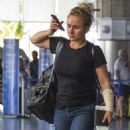 Hayden Panettiere in Jeans at Airport in Barbados - 454 x 582