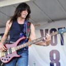 Rudy Sarzo, bassist of the band Blue Oyster Cult, performs during the New York Islanders fan rally at Nassau Coliseum on July 27, 2011 in Uniondale, NY