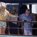 Queen's Roger Taylor uses a pole and shoots an AIRGUN at jellyfish whilst on a boat ride with his wife and children during sun-soaked holiday in Spain, 31 May 2019 - 454 x 320