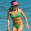 Andrea Corr in Green Bikini on the beach in Barbados - 454 x 681