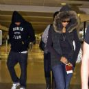 Rihanna And Chris Brown At LAX Airport - December 7, 2008