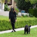 Troian Bellisario – Out for a walk with her dog in Los Angeles - 454 x 465