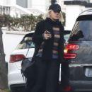 Rita Ora in Long Black Coat – Out in London - 454 x 677
