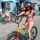 Phoebe Price in Bikini – Riding a bike in Venice Beach - 454 x 681