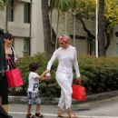 Jennifer Lopez and her kids Max and Emme enjoy at day out with family members before hitting the pool for lunch and a swim in Miami