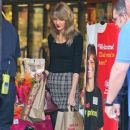 Taylor Swift shops for groceries at Ralph's in West Hollywood, California with her bodyguard on January 3, 2014