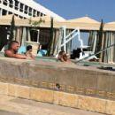 Hailey Baldwin in Bikini at a pool in Los Angeles