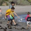 Justin Bieber and Selena Gomez spending time with Justin's family on the beach in Malibu, CA on February 17, 2012