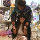 Jaden Smith puts his arms around Kylie Jenner and shows her an item while shopping together at Crystalarium on Tuesday (November 19) in West Hollywood, Calif - 454 x 743