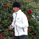 Sean Penn goes for a jog on January 3, 2014 in Los Angeles, California after spending the earlier part of his day with his new love interest Charlize Theron!