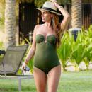 Danielle Lloyd in Green Swimsuit in Dubai - 454 x 710